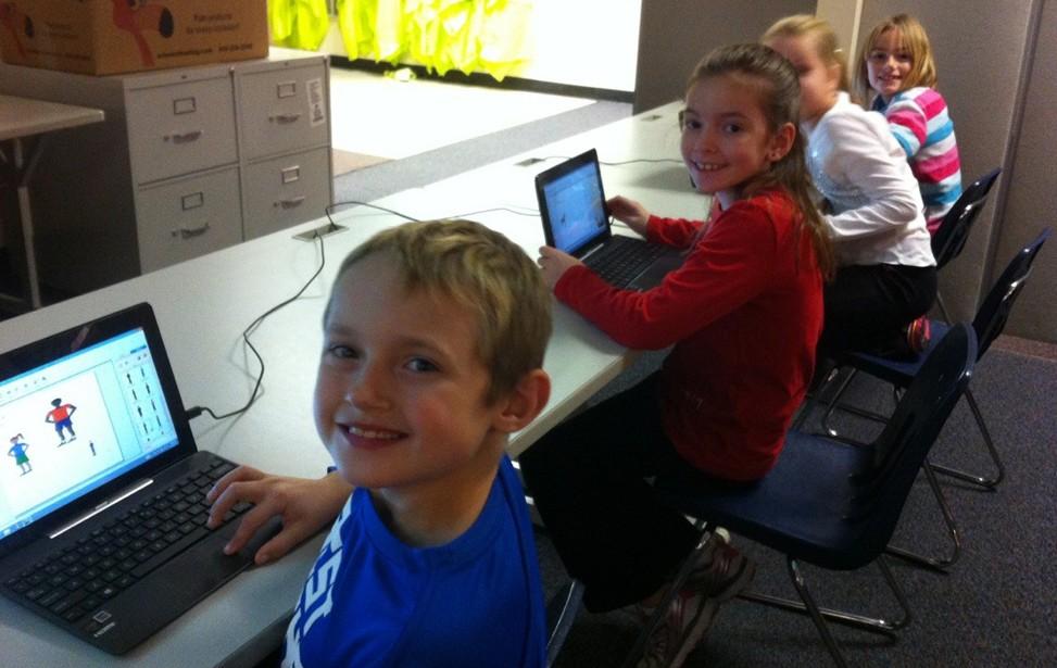 Children using tablet computers